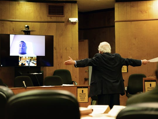 Miles Feinstein, attorney for Troy Dye, gestures as he questions Victor Mercado via Skype in the courtroom on Monday.
