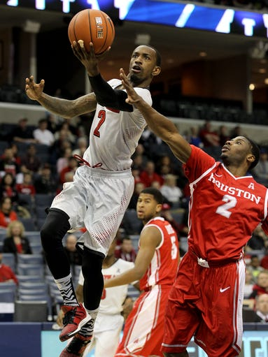 U of L's Russ Smith, #2, scores against Houston's Brandon Morris, #2, during the AAC Tournament at the FedEx Forum in Memphis, Tn. Mar. 14, 2014
