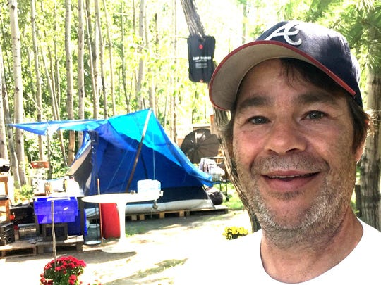 Walter Putnam, 55, pauses Wednesday while working to help a homeless person choose a camp site in Burlington's South End. Before finding permanent housing, Putnam lived in the camp. Photographed Aug. 30, 2017.