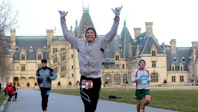 About 1,300 runners braved extreme weather conditions during the inaugural Asheville Marathon at the Biltmore Estate. Registration for the 2016 race opens Saturday.