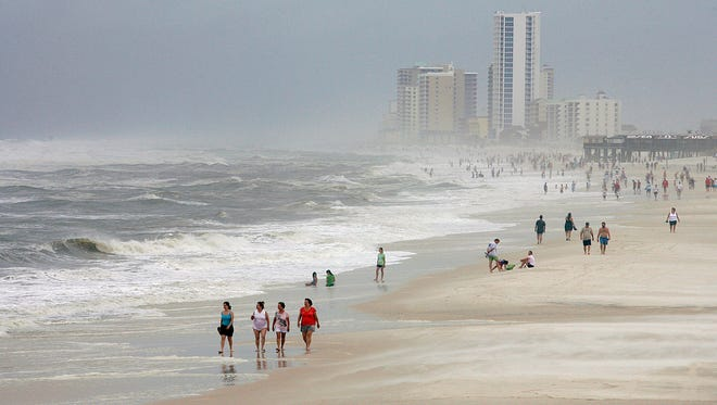 In a Sept. 3, 2011 file photo, tourists watch the churning waves from Tropical Storm Lee at Gulf State Park in Gulf Shores, as Tropical Storm Lee approaches the Gulf Coast. Over 10 years ago, Hurricane Ivan knocked down a 1970s-era state park lodge at the park.