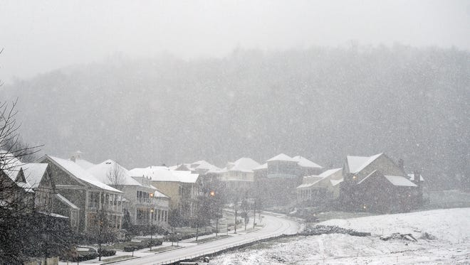 Snow falls on homes and streets of Westhaven in Franklin on Friday Jan. 22, 2016.