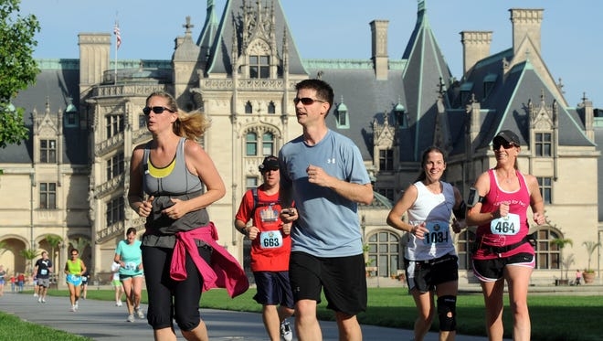 Participants in the Biltmore Kiwanis Classic 15K run past the Biltmore House in a past race. The race is Sunday, May 15.