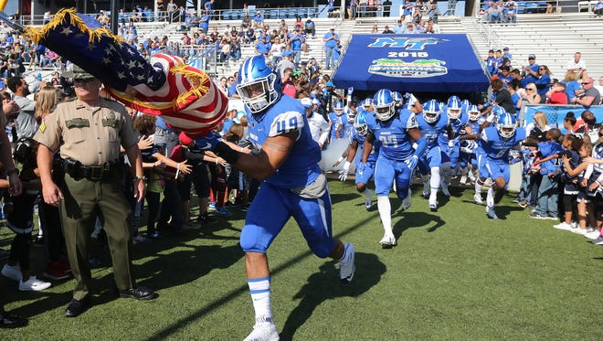 MTSU's Steven Rhodes (49) and Marine Veteran charges onto the field with the American Flag before the start of the UTSA game on Saturday, Nov. 5, 2016. Rhodes accepted an invite to the Titans mini-camp following the NFL draft on Saturday.