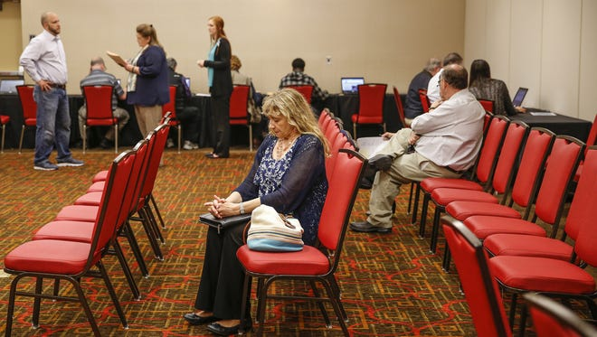 "Jan Forton sits quietly as she waits for her one-on-one interview with a local Kroger manager during a Kroger job fair held at the Drury Plaza Hotel Indianapolis Carmel on Thursday, May 11, 2017. Forton has a full-time job but worked weekends at the Greyhound Pass Marsh to make ends meet. She was also laid off from her full-time job in May 2016 but was able to find another. ""I knew it was coming but I didn't know it was coming this fast,"" she said. ""It devastates you. It's going to be a hardship for me to pay all of my bills until I find another part-time job to supplement."""