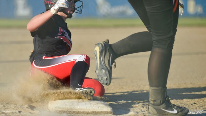 Cardington's Liz Horton slides in to third during a Division III district semifinal against Amanda-Clearecreek at Olentangy High School.