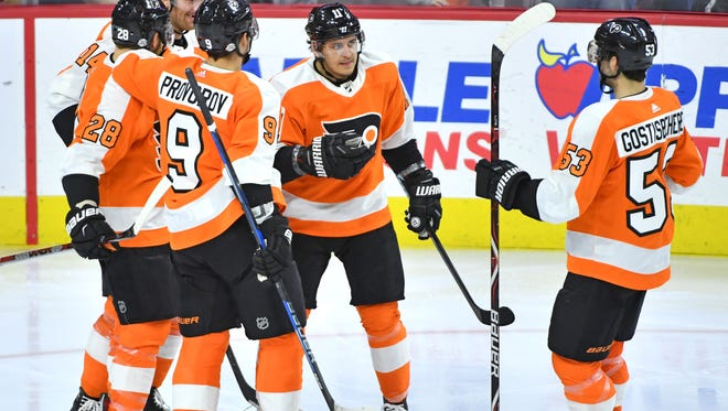 Travis Konecny, center, is one point away from matching his total last season.