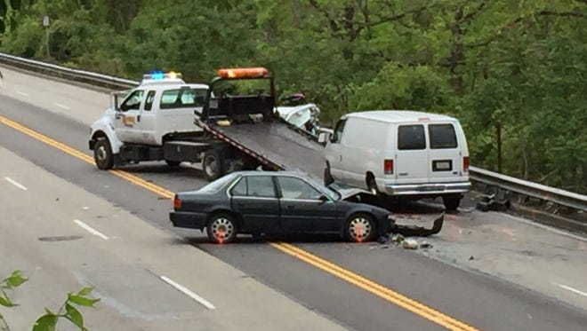 A tow truck removes a vehicle involved in a fatal crash Thursday on Columbia Parkway.