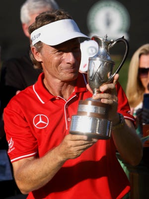 Bernhard Langer, of Germany, poses with the championship trophy after winning the PGA Regions Tradition at the Greystone Golf & Country Club in Birmingham, Ala., Sunday, May 22, 2016.