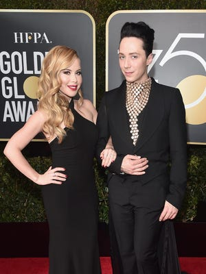 Figure skaters Tara Lipinski and Johnny Weir attend the 75th Annual Golden Globe Awards at The Beverly Hilton Hotel on Jan. 7, 2018 in Beverly Hills, Calif.