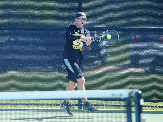 Snyder's Trace Chapman hits a backhand during the District