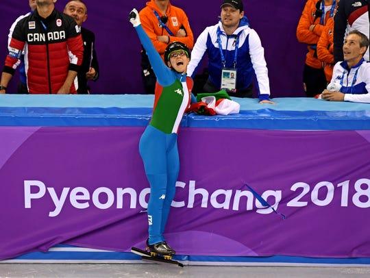 Arianna Fontana (ITA) celebrates winning gold in the