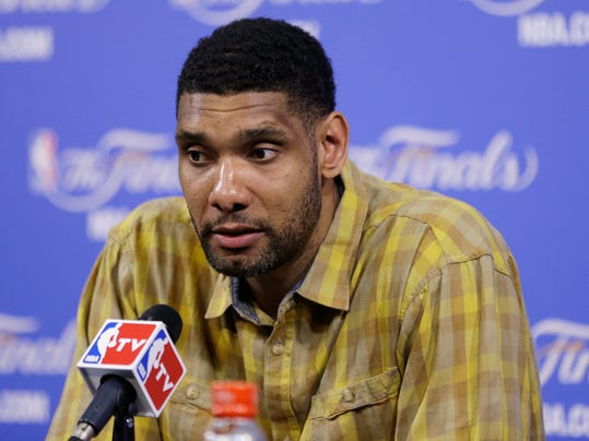 San Antonio Spurs Tim Duncan speaks during the post-game news conference after Game 3 of the NBA basketball finals, Wednesday, June 11, 2014, in Miami. The Spurs defeated the Heat 111-92. (AP Photo/Lynne Sladky)