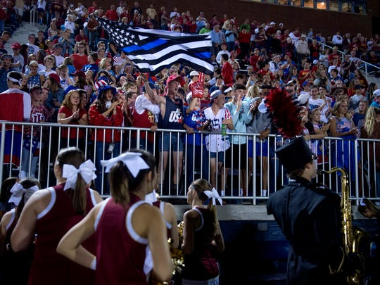 Mater Dei Wildcats students dressed in America-themed costumes during the game between the Memorial Tigers and the Mater Dei Wildcats at the Reitz Bowl in Evansville, Ind., on Friday, Sept. 8, 2017. Memorial won 37-14.