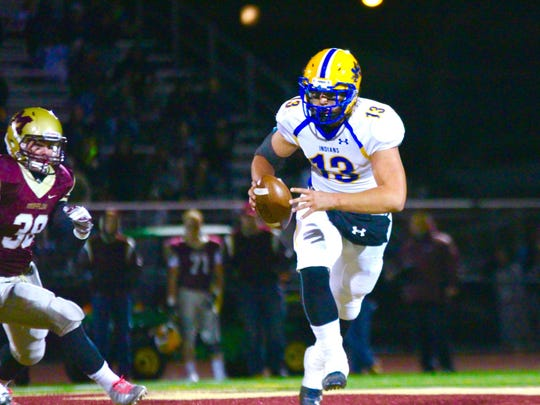 Governor Mifflin's Phillip Henry (38) pursues Brady Riddell, of Waynesboro, during a District 3 Class 5A football game on Friday, Nov. 11. The Mustangs won, 41-14.