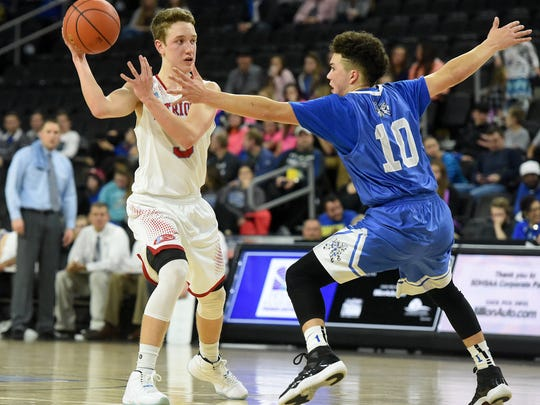 Lincoln's Carson Coulter passes over Rapid City Stevens' Mason Archambault during their game at the Premier Center on Friday, March 18, 2016.