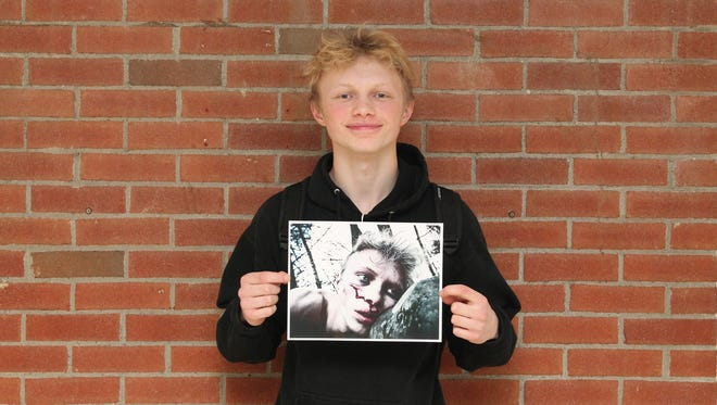 """New Paltz High School juniort Morgan Heidrich holds his photograph """"Forgotten,"""" which won a gold medal in the 2017 Scholastic Art & Writing Awards."""