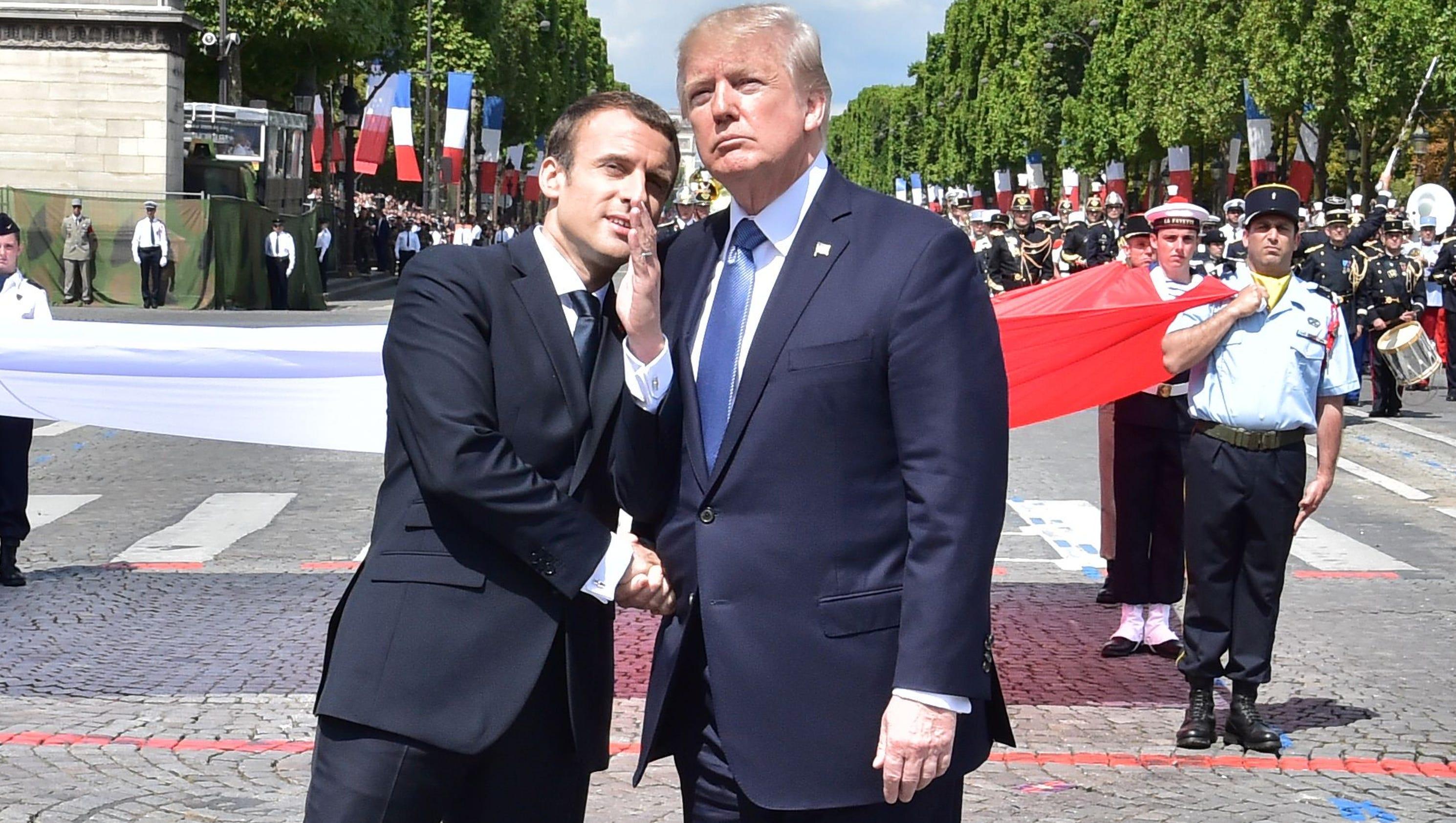 Trump and Macron share their strangest handshake yet
