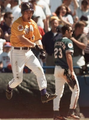 Warren Morris rounds first base after hitting the home run that won the 1996 College World Series for LSU.