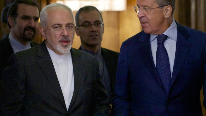 Iranian Foreign Minister Mohammad Javad Zarif, left, chats with Russian Foreign Minister Sergey Lavrov upon being welcomed by Lavrov for their meeting in Moscow, Russia, on Monday, Aug. 17, 2015. The two are holding talks expected to focus on the implementation of the nuclear deal between Tehran and world powers, as well as international efforts to mediate the conflict in Syria.