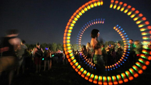 Alexis Celino of Maple Shade, N.J. dances to the music of Krewella twirling her night sticks at Firefly in 2013.