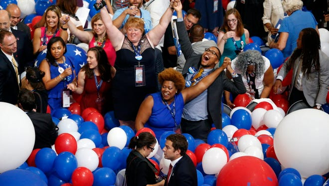 Convention-goers have fun in a pile of balloons at the conclusion of the Democratic convention in Philadelphia on July 28, 2016.