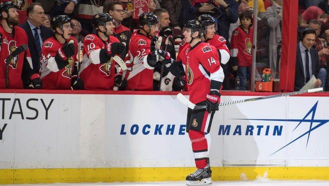 Ottawa Senators froward Alexandre Burrows (14) scores an empty-net goal in the third period against the Boston Bruins.