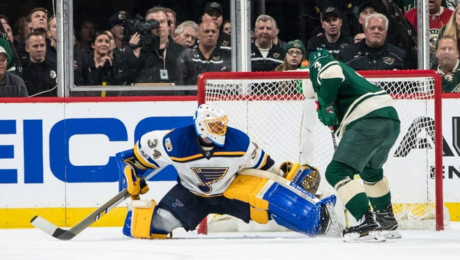 St. Louis Blues goalie Jake Allen (34) makes a save on Minnesota Wild forward Charlie Coyle (3) during the second period.