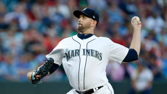 Seattle Mariners starting pitcher James Paxton (65) throws against the Boston Red Sox during the third inning at Safeco Field.