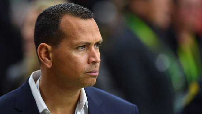 This file photo from 2017 shows former MLB star Alex Rodriguez looks on from the sidelines before Super Bowl LI between the Falcons and Patriots at NRG Stadium in Houston.