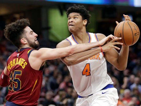 Cleveland Cavaliers' London Perrantes, left, knocks the ball loose from New York Knicks' Isaiah Hicks in the second half of an NBA basketball game, Wednesday, April 11, 2018, in Cleveland. The Knicks won 110-98. (AP Photo/Tony Dejak)