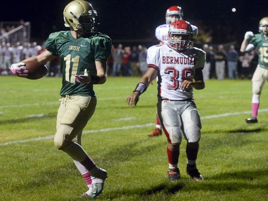 York Catholic's Dan Yokemick (11) glances back at a referee after scoring a touchdown against Bermudian Springs in the first half of a football game last season at York Catholic. (FILE -- GAMETIMEPA.COM)