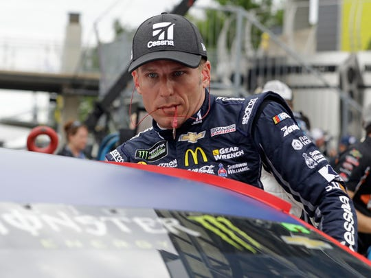 Jamie McMurray climbs into his car at the start of qualifying for the NASCAR Cup auto race at Indianapolis Motor Speedway, in Indianapolis on Saturday, July 22, 2017. (AP Photo/Darron Cummings)
