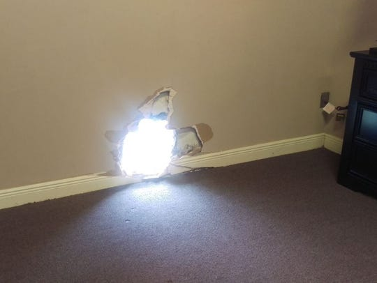 Inside view of a hole made in the wall to gain entry