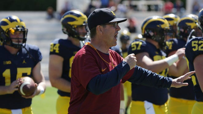 Michigan football coach Jim Harbaugh leads his Wolverines during their last practice at Stadio dei Marmi in Rome on Saturday, April 29, 2017.