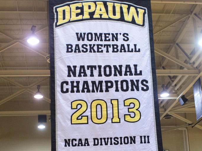 Players from last season watch as a championship banner is raised before DePauw University beat Kenyon College 80-47, Greencastle, February 15, 2014. DePauw is the reigning Division III women's national basketball champion and is undefeated this season at 24-0.
