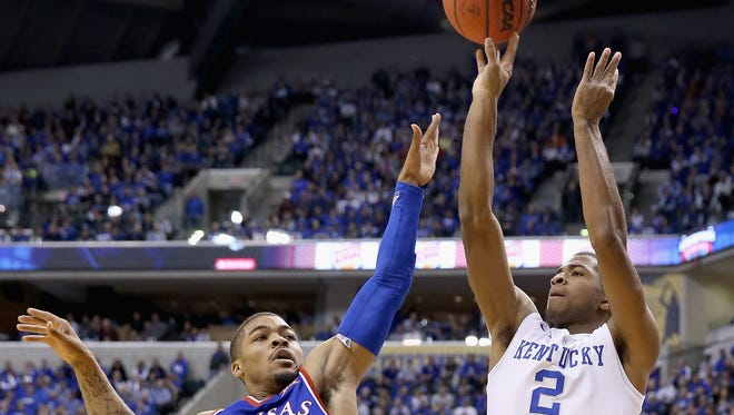 INDIANAPOLIS, IN - NOVEMBER 18:  Aaron Harrison #2 of the Kentucky Wildcats shoots the ball during the game against the Kansas Jayhwaks in the State Farm Champions Classic at Bankers Life Fieldhouse on November 18, 2014 in Indianapolis, Indiana.  (Photo by Andy Lyons/Getty Images)