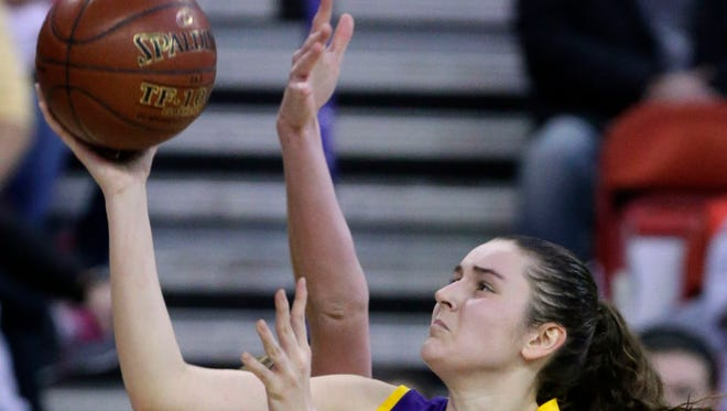 Cudahy's Hannah Kulas makes a shot despite efforts from Hortonville's Morgan Allen.