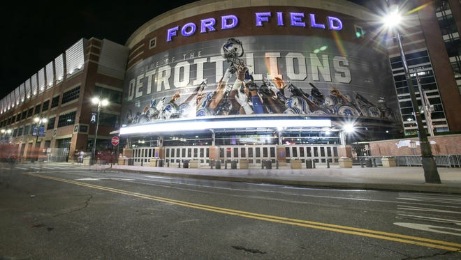 Ford Field in Detroit is illuminated at night, photographed on Tuesday, Aug. 16, 2016.
