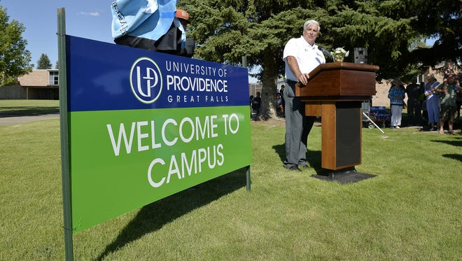 Tony Aretz, president of the University of Providence, unveils the new name and logo during a ceremony last year.