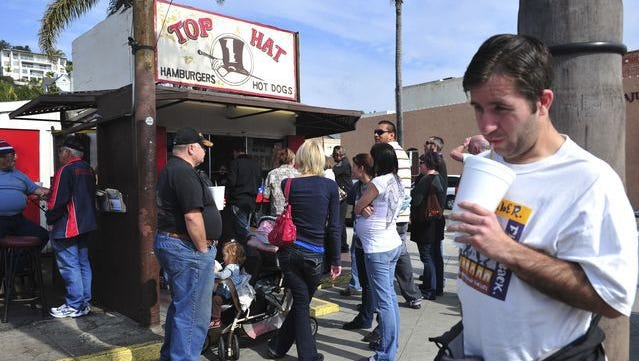 Patrons line up at Top Hat burger stand in downtown Ventura on its last day of business in February 2010. Plans to include the local landmark stand in a proposed condominium development were discussed Wednesday during a meeting of the Ventura Historic Preservation Committee.