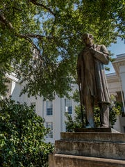 The statue of Dr. James Marion Sims sits in the shade