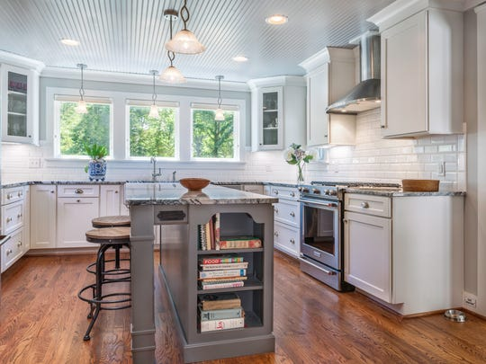 The old kitchen was completely removed and a new kitchen was built in the side wing where it is bathed in daylight from morning to evening.
