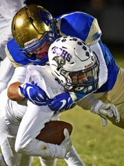 Reed's Jake Olson tackles Spanish Springs' Maleik Lariviere at Reed High School on Oct. 27.