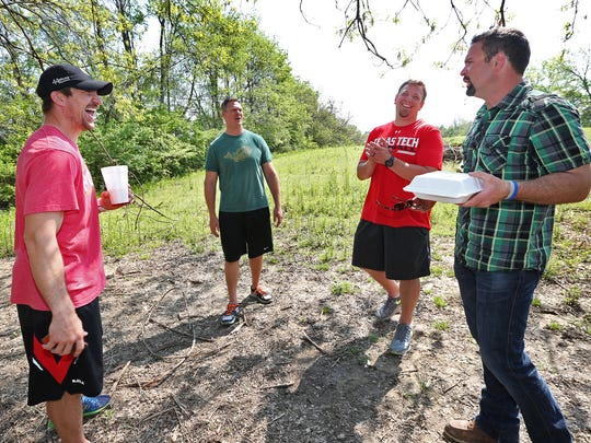 Former Indianapolis Colts punter Hunter Smith, right, talks with his friends, former Colts players Dallas Clark, from left, Ryan Diem, and Dylan Gandy, who stopped by to visit him, Thursday, May 7, 2015.  Smith has traded football in for music and is set to release a new album.