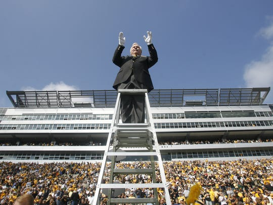 Kevin Kastens, director of the UI Marching Band, conducts