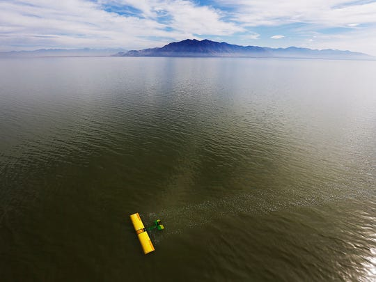 A small plane floats in the Great Salt Lake after crashing,