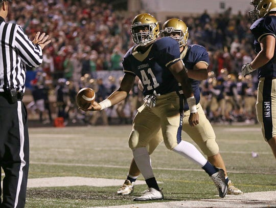Cathedral running back Markese Stepp (41)