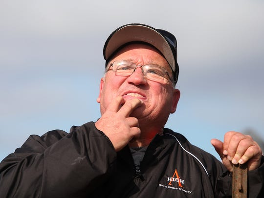 Ames girls' cross country coach Kirk Schmaltz whistles