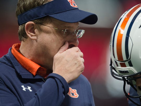 Auburn head coach Gus Malzahn speaks to Auburn quarterback